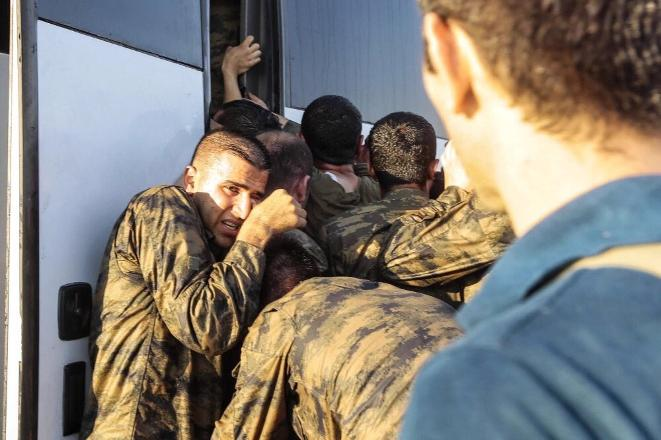 Even after they surrendered their weapons, soldiers who participated in the failed coup were attacked by Erdogans supporters. Photograph: http://www.cumhuriyet.com.tr/