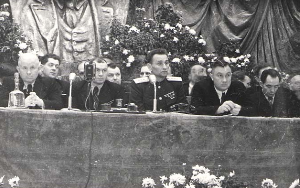 N.S. Khrushchev, F.V. Mokienko, A.A. Hrechko,  and P.H. Tychyna (far right) at the Celebrations of the 28th Anniversary of the October  Revolution, November 7, 1945.  Reproduced with Permission of the H.S. Pshenychnyi Ukrainian Central State Archive of Cinematic, Photo, and Audio Sources.